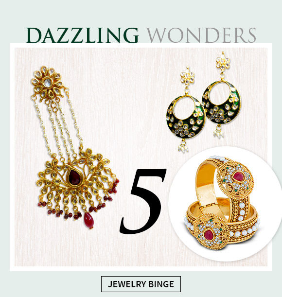 Select from our beautiful repertoire of stone studded necklaces, chandlier earrings and maang teekas.